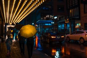 A rainy night in Boston Common beside the Paramount theater.
